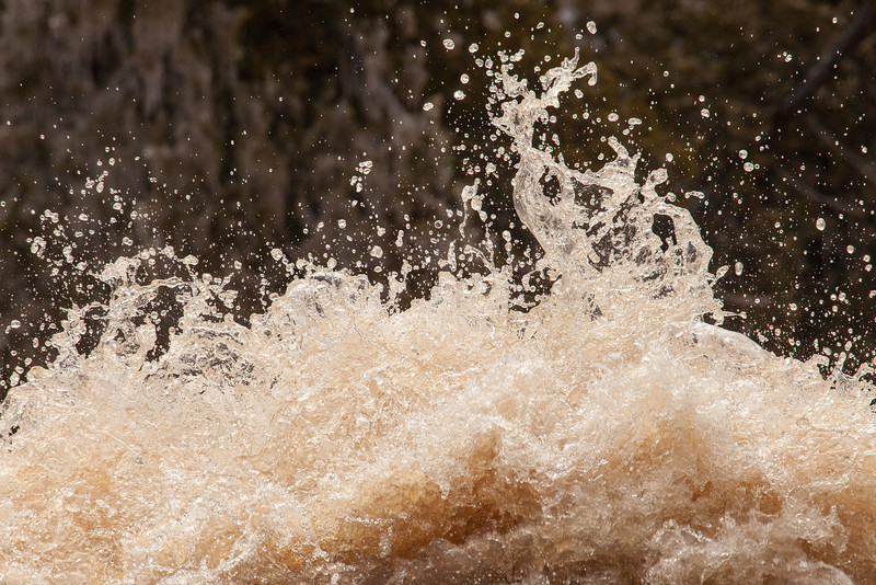 """WEDNESDAY, APRIL 30, 2014<br /> <br /> GOOSEBERRY RIVER 4100<br /> <br /> """"Spring Explosion""""<br /> <br /> The rivers are running!  The rivers are running!  It's been a long time coming this year, but the rivers are all open now and flowing freely on their way to Lake Superior.  It's a great time to head out and photograph the """"rush"""" of spring.  This photograph was made last week at Gooseberry Falls State Park just north of Two Harbors, MN and shows the water exploding into the air just before it drops over the top of Lower Gooseberry Falls.  Gooseberry is one of the most enjoyable rivers to photograph because of the nice trails along both sides of the river which provide for infinite photo possibilities.  <br /> <br /> Camera: Canon EOS 5D Mark II<br /> Lens: Tamron SP 150-600mm<br /> Focal length: 600mm<br /> Shutter speed: 1/800<br /> Aperture: f/16<br /> ISO: 800"""