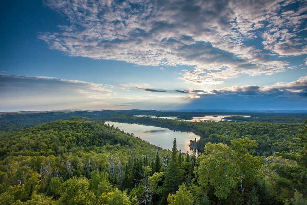 """FRIDAY, AUGUST 15, 2014<br /> <br /> LAKES 8993<br /> <br /> """"August Evening over the Minnesota Northwoods""""<br /> <br /> A recent shot from one of my favorite places on this planet upon which we live.  The view never fails to impress!  In about another month this will be an even more glorious view as the leaves make the transformation to their autumn colors.<br /> <br /> Camera: Canon EOS 5D Mark II<br /> Lens: Canon EF 17-40mm<br /> Focal length: 17mm<br /> Shutter speed: 1/60<br /> Aperture: f/16<br /> ISO: 400"""