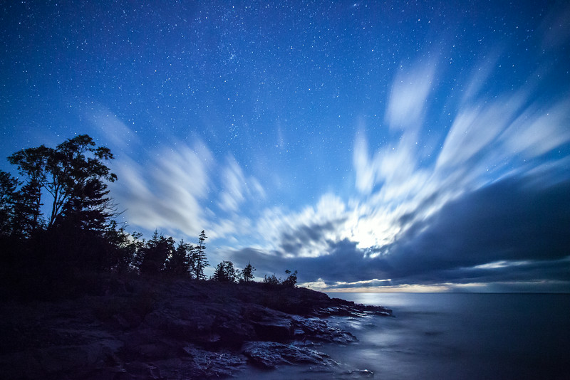 "TUESDAY, AUGUST 19, 2014<br /> <br /> MOONLIGHT 9054<br /> <br /> ""Superior Shines in the August Moonlight""<br /> <br /> An image from this past weekend during the half-moon over Lake Superior. The moonlight, stars and clouds were all incredible on this night.  Everything came together for some amazing imagery!  This is a 30 second exposure taken at 12:20 AM on August 17th.<br /> <br /> Camera: Canon EOS 5D Mark II<br /> Lens: Canon EF 17-40mm<br /> Focal length: 17mm<br /> Shutter speed: 30 seconds<br /> Aperture: f/4<br /> ISO: 6400"