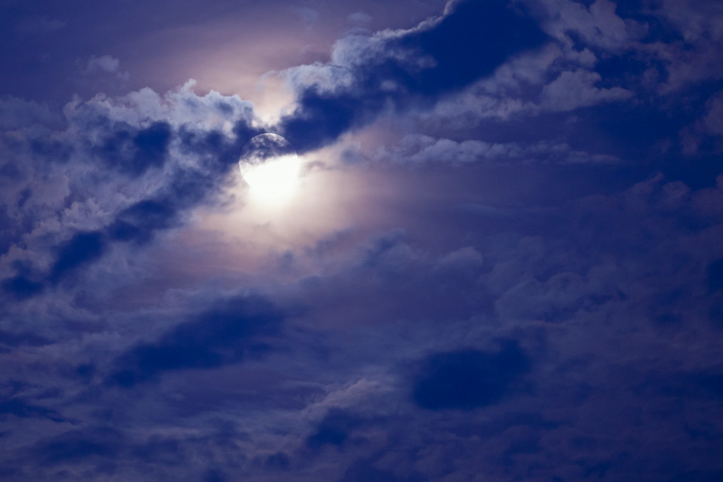 """WEDNESDAY, AUGUST 13, 2014<br /> <br /> MOONLIGHT 8944<br /> <br /> """"August Perigee Moon""""<br /> <br /> The moonlight this past weekend was extraordinary thanks to the moon being at perigee, which is its closest position to Earth in its 27.3 day cycle between perigee and apogee (the point at which it is furthest from Earth).  The full moon occurred at roughly the same time as perigee, making for what has become known as a """"supermoon"""".  I don't know about all that, but I do know that it sure made for some incredibly bright moonlight over the weekend!  And, combined with this really cool cloud cover just after sunset, made for a pretty spectacular photo as well.  I made this image with my Tamron 150-600 telephoto lens from our front yard.<br /> <br /> Camera: Canon EOS 5D Mark II<br /> Lens: Tamron SP 150-600mm<br /> Focal length: 226mm<br /> Shutter speed: 0.3 seconds<br /> Aperture: f/5.6<br /> ISO: 800"""