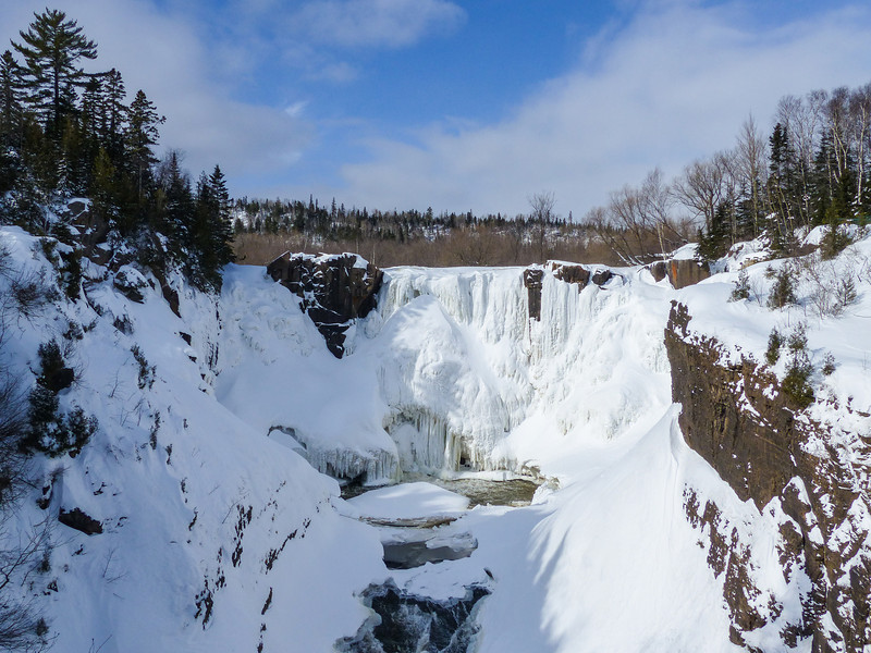 "THURSDAY, FEBRUARY 20, 2014<br /> <br /> PIGEON RIVER 1010972<br /> <br /> ""High Falls in February 2014""<br /> <br /> With all the hardy winter weather we've had this season, the buildup of ice and snow has been tremendous at High Falls in Grand Portage State Park.  This photo was taken a couple of weeks ago but the falls still looks similar today to what you see in this photo.  If you've never seen the waterfall in winter, now is the time as it is beautiful and after tomorrow will be even more beautiful with the foot or more of snow that we are supposed to be getting tonight! <br /> <br /> Camera: Panasonic DMC-FZ200<br /> Focal length: 31mm<br /> Shutter speed: 1/1600<br /> Aperture: f/5<br /> ISO: 100"