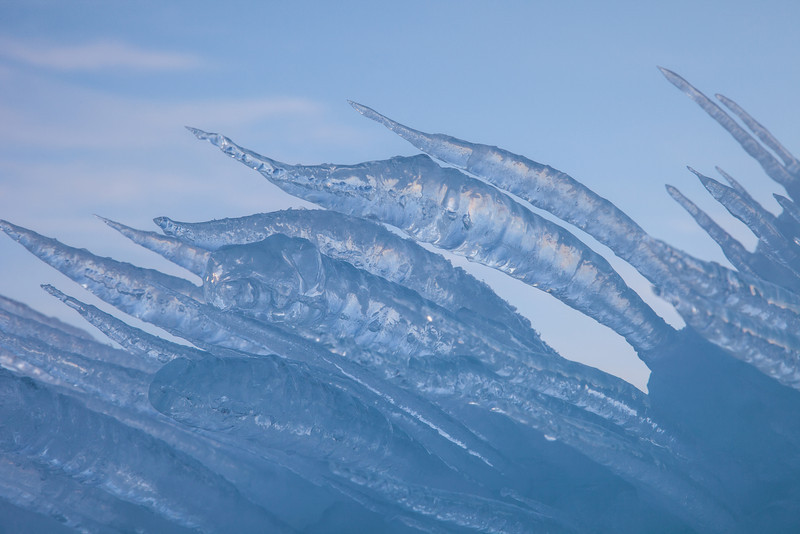 "SUNDAY, FEBRUARY 16, 2014<br /> <br /> ABSTRACT 0678<br /> <br /> ""Frozen Swordfish""<br /> <br /> I cannot say enough how much I enjoy photographing ice!  Especially abstract formations of ice like the one shown here.  I couldn't help it, when I first laid eyes on this formation I thought it looked like a school of swordfish leaping from the sea.  I used my 100-400mm lens to isolate the ""fish"" against the sky and photographed the scene after the sun had gone down to add a more dramatic feel to the shot.  <br /> <br /> Camera: Canon EOS 5D Mark II<br /> Lens: Canon EF 100-400mm<br /> Focal length: 105mm<br /> Shutter speed: 1/20<br /> Aperture: f/16<br /> ISO: 200"