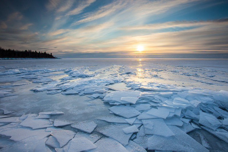 "WEDNESDAY, FEBRUARY 12, 2014<br /> <br /> SUPERIOR WINTER 0613<br /> <br /> ""Frosted Plate Ice Sunrise""<br /> <br /> From a sunrise this past weekend.  A gloriously calm morning on Lake Superior.  The ice has been building up steadily lately and making for some nice photographs.  I love photographing ice in all its forms, but plate ice is one of my favorites.  It just adds so much beauty and interest to a photo.  I hope we get a lot more of this stuff before winter is over!<br /> <br /> Camera: Canon EOS 5D Mark II<br /> Lens: Canon EF 17-40mm<br /> Focal length: 17mm<br /> Shutter speed: 1/40<br /> Aperture: f/16<br /> ISO: 200"