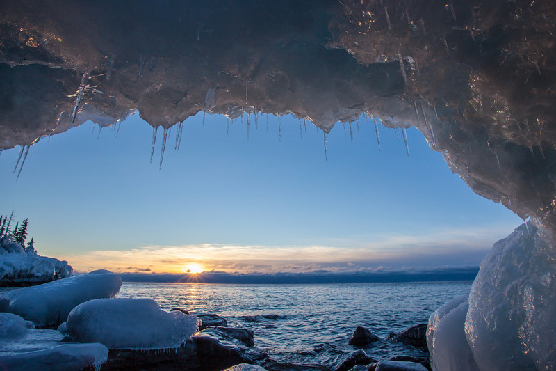 "TUESDAY, JANUARY 14, 2014<br /> <br /> SUPERIOR WINTER 0114<br /> <br /> ""Ice Cave Sunrise, Horseshoe Bay""<br /> <br /> It sure felt good this morning to get out and take some sunrise pictures, the first time I've gotten out with the camera since 8 days ago!  I ended up getting pretty sick from spending so much time out in the VERY cold weather during the dog race.  The doctor told me that my lungs might have actually gotten frostbite!  At any rate, I had a really bad wheezing cough for over a week but I'm feeling better now so this morning I had to get out and take some pictures.  I went to Horseshoe Bay in Hovland, one of my favorite locations for Lake Superior sunrise photos.  I found some nice ice caves and arches down there and had a great time photographing them.  <br /> <br /> Camera: Canon EOS 5D Mark II<br /> Lens: Canon EF 17-40mm<br /> Focal length: 17mm<br /> Shutter speed: 1/100<br /> Aperture: f/16<br /> ISO: 400"