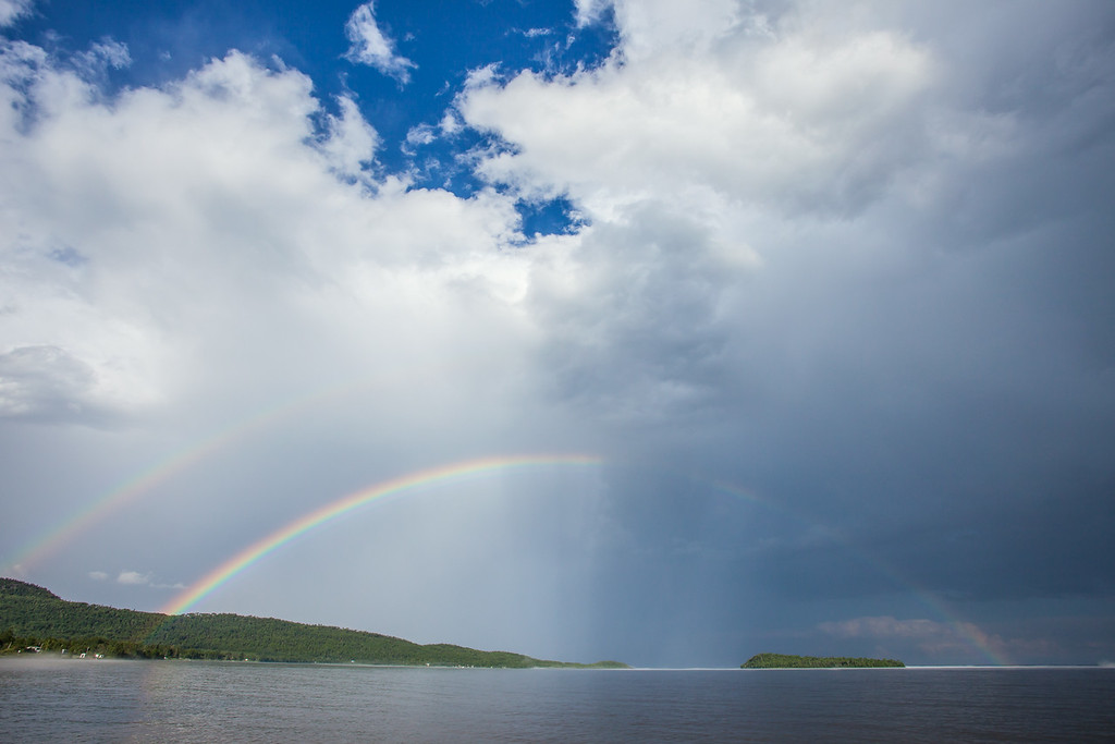 "TUESDAY, JULY 8, 2014<br /> <br /> SUPERIOR SUMMER 8254<br /> <br /> ""Double Rainbow over Grand Portage Bay""<br /> <br /> The storms that we had over the weekend produced some nice rainbows, like this one on Sunday afternoon over Hat Point and Pete's Island in Grand Portage Bay.  I made this photo from the lakeshore picnic area at Grand Portage National Monument.  I was driving home from work in a torrential downpour and just before arriving at the picnic area the rain stopped and the sky started to clear.  When I looked across the bay there was this big, beautiful double rainbow!  Of course I had to stop and make some images of the scene :-)<br /> <br /> Camera: Canon EOS 5D Mark II<br /> Lens: Canon EF 17-40mm<br /> Focal length: 17mm<br /> Shutter speed: 1/250<br /> Aperture: f/16<br /> ISO: 200"