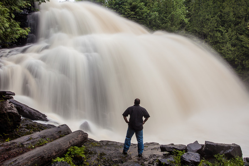 """MONDAY, JUNE 23, 2014<br /> <br /> PIGEON RIVER 7871<br /> <br /> """"The Power of Partridge Falls""""<br /> <br /> Last night I visited Partridge Falls for the first time this year.  I've often said that Partridge Falls is my favorite of all waterfalls and I would say that still holds true.  There is just something about it that amazes me more than any other waterfall.  For one thing, I love the fact that you can stand right at the base of it and literally get drenched from the spray.  And that is exactly what happened in the making of this shot.  <br /> <br /> The mosquitoes are pretty awful right now so before walking down to the falls I coated myself with a liberal dose of bug spray.  This worked great for the hike down to the falls as the mosquitoes barely landed on me.  In order to make this shot I had to stand directly in the path of the mist that was shooting out from the base of the falls.  I only stood in that spot for about half a minute but in that time I got totally soaked which, of course, washed off most of the bug spray!  The walk back to the truck was an ordeal as I felt like I was getting eaten alive by the mosquitoes.  Just one of the many things I put myself through in order to bring you these images :-)<br /> <br /> Camera: Canon EOS 5D Mark II<br /> Lens: Canon EF 17-40mm<br /> Focal length: 27mm<br /> Shutter speed: 1.3 seconds<br /> Aperture: f/16<br /> ISO: 100"""