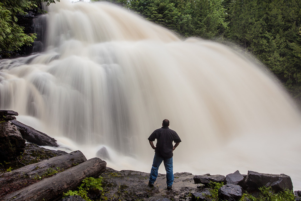 "MONDAY, JUNE 23, 2014<br /> <br /> PIGEON RIVER 7871<br /> <br /> ""The Power of Partridge Falls""<br /> <br /> Last night I visited Partridge Falls for the first time this year.  I've often said that Partridge Falls is my favorite of all waterfalls and I would say that still holds true.  There is just something about it that amazes me more than any other waterfall.  For one thing, I love the fact that you can stand right at the base of it and literally get drenched from the spray.  And that is exactly what happened in the making of this shot.  <br /> <br /> The mosquitoes are pretty awful right now so before walking down to the falls I coated myself with a liberal dose of bug spray.  This worked great for the hike down to the falls as the mosquitoes barely landed on me.  In order to make this shot I had to stand directly in the path of the mist that was shooting out from the base of the falls.  I only stood in that spot for about half a minute but in that time I got totally soaked which, of course, washed off most of the bug spray!  The walk back to the truck was an ordeal as I felt like I was getting eaten alive by the mosquitoes.  Just one of the many things I put myself through in order to bring you these images :-)<br /> <br /> Camera: Canon EOS 5D Mark II<br /> Lens: Canon EF 17-40mm<br /> Focal length: 27mm<br /> Shutter speed: 1.3 seconds<br /> Aperture: f/16<br /> ISO: 100"