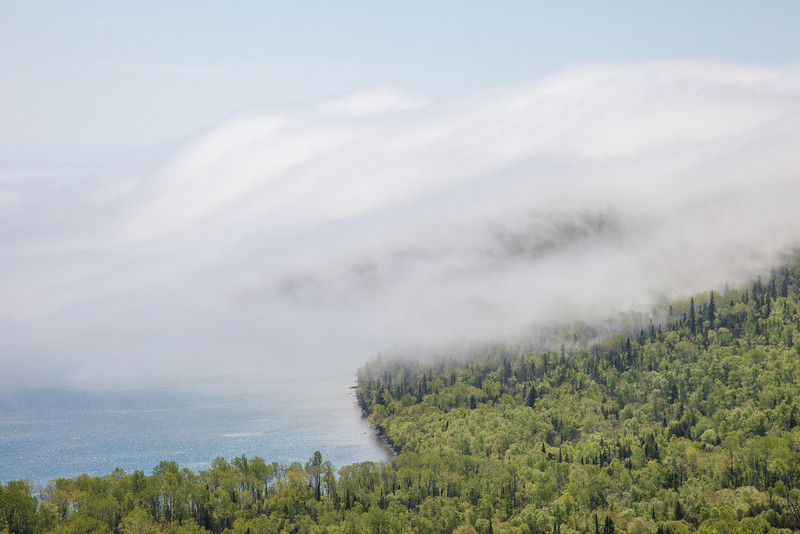 "SATURDAY, JUNE 7, 2014<br /> <br /> SUPERIOR SUMMER 5093<br /> <br /> ""Fog bank rolling over Mt. Josephine""<br /> <br /> The fog on Lake Superior yesterday was incredible!  It was one of those rare days where there was a ton of fog combined with some fairly strong breezes.  The fog was rolling over the top of Mt. Josephine for several hours during the middle of the day.  Keep in mind that the summit of Mt. Josephine is 700 feet above the surface of Lake Superior and the fog was rolling over it like it was nothing more than a mere speed bump!  It was fascinating to witness.<br /> <br /> Camera: Canon EOS 5D Mark II<br /> Lens: Canon EF 24-105mm<br /> Focal length: 105mm<br /> Shutter speed: 1/640<br /> Aperture: f/16<br /> ISO: 400"