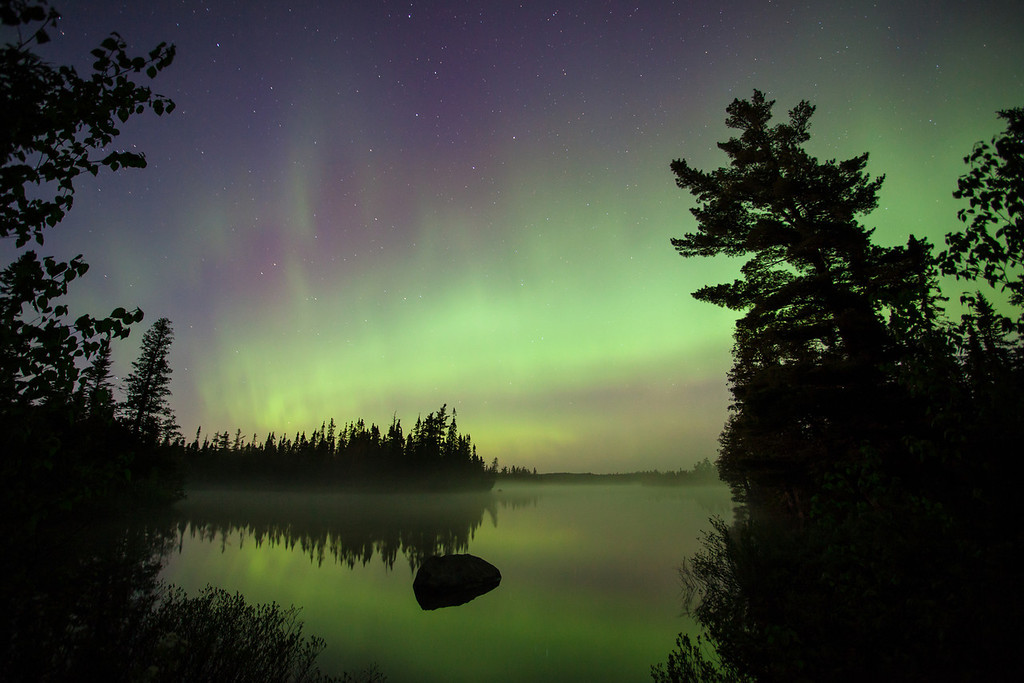 "SUNDAY, JUNE 8, 2014<br /> <br /> AURORA 7352<br /> <br /> ""June Aurora over Devilfish Lake""<br /> <br /> The northern lights were out last night for the first time in a while.  It sure was good to see them again as it seems like its been forever since the last good show.  Last night's lights weren't the best I've seen but they were pretty darn good!  This photo was made at 1:30 AM on Devilfish Lake in Cook County, MN.  Devilfish Lake is one of the best spots I've found for photographing the aurora over calm water. It's also one of the best spots for mosquitoes.  I was wearing my rain jacket with the hood cinched tight over my head in an attempt to keep the mosquitoes from harassing me too badly.  I was also wearing gloves, since the temperature was 36 degrees.  Still, every now and then a mosquito would find its way inside my hood and buzz louder than you ever thought possible from such a small insect.  The bugs were a pain in the butt last night, but the amazingly beautiful skies were worth the frustration of the insects.<br /> <br /> Camera: Canon EOS 5D Mark II<br /> Lens: Canon EF 17-40mm<br /> Focal length: 17mm<br /> Shutter speed: 30 seconds<br /> Aperture: f/4<br /> ISO: 1000"