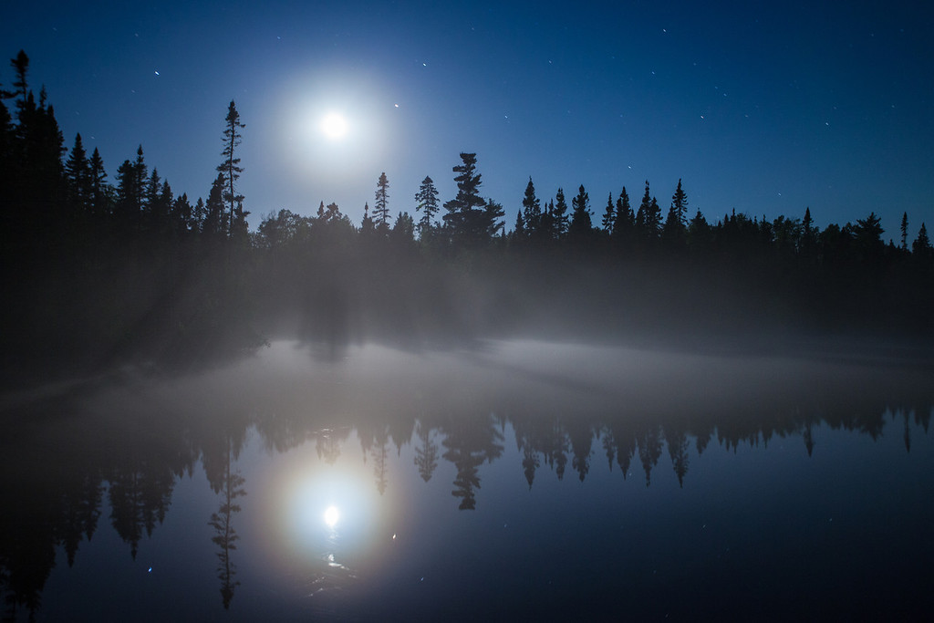 "FRIDAY, JUNE 13, 2014<br /> <br /> MOONLIGHT 7336<br /> <br /> ""Moon and Fog over Devilfish Lake""<br /> <br /> Last weekend I experienced one heck of an awesome night of photography!  You've already seen my shots of the northern lights over Devilfish Lake and the Milky Way Galaxy over Esther Lake, shared earlier this week. Here is the first shot that I made that evening when I arrived at Devilfish Lake.  The moon and the fog over the lake were beautiful!  I hope to experience another night like this soon.  It was a night that I will never forget!<br /> <br /> Camera: Canon EOS 5D Mark II<br /> Lens: Canon EF 17-40mm<br /> Focal length: 35mm<br /> Shutter speed: 30 seconds<br /> Aperture: f/4<br /> ISO: 400"