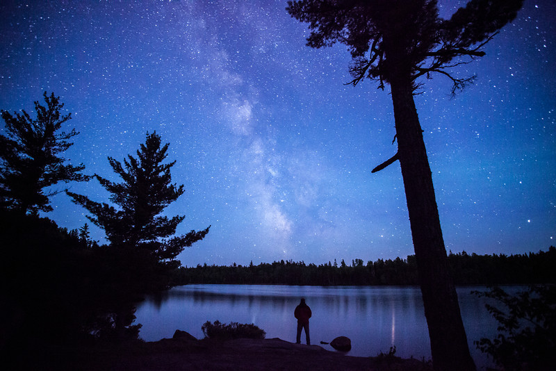 """MONDAY, JUNE 9, 2014<br /> <br /> MILKY WAY 7406<br /> <br /> """"The sight of the stars makes me dream""""<br /> <br /> Certain things always inspire a sense of awe and wonder, and the Milky Way Galaxy is one of them.  While out photographing the northern lights this past weekend I also got some nice shots of the Milky Way.  Around 2:00 AM the northern light activity was subsiding so I turned my lens to the south to photograph the stars.  The view was astounding.  I couldn't help walking out into the frame to make this self-portrait.  I think adding the human element into the scene helps convey that sense of wonder and amazement of the night sky.  If you don't take time to appreciate the night sky and all its wonders, I urge you to do so.  You won't regret it :-)<br /> <br /> Camera: Canon EOS 5D Mark II<br /> Lens: Canon EF 17-40mm<br /> Focal length: 17mm<br /> Shutter speed: 30 seconds<br /> Aperture: f/4<br /> ISO: 6400"""