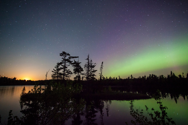 """SUNDAY, JUNE 8, 2014<br /> <br /> AURORA 7370<br /> <br /> """"Moonset and Northern Lights over Esther Lake""""<br /> <br /> 2:00 AM last night on Esther Lake in Grand Portage State Forest.  I had been photographing the aurora over Devilfish Lake for the previous hour and figured I'd head over to Esther Lake and see if I could find any good shots there.  I had never been to Esther Lake during aurora activity and wasn't sure if it would work out.  As it turns out, it was quite nice!  I arrived just as the moon was setting which made for a really beautiful scene with the moon on the left and the aurora on the right.  The entire show was going on directly over the small island that is near the campsites.  It sure was a beautiful sight!<br /> <br /> Camera: Canon EOS 5D Mark II<br /> Lens: Canon EF 17-40mm<br /> Focal length: 17mm<br /> Shutter speed: 30 seconds<br /> Aperture: f/4<br /> ISO: 2500"""