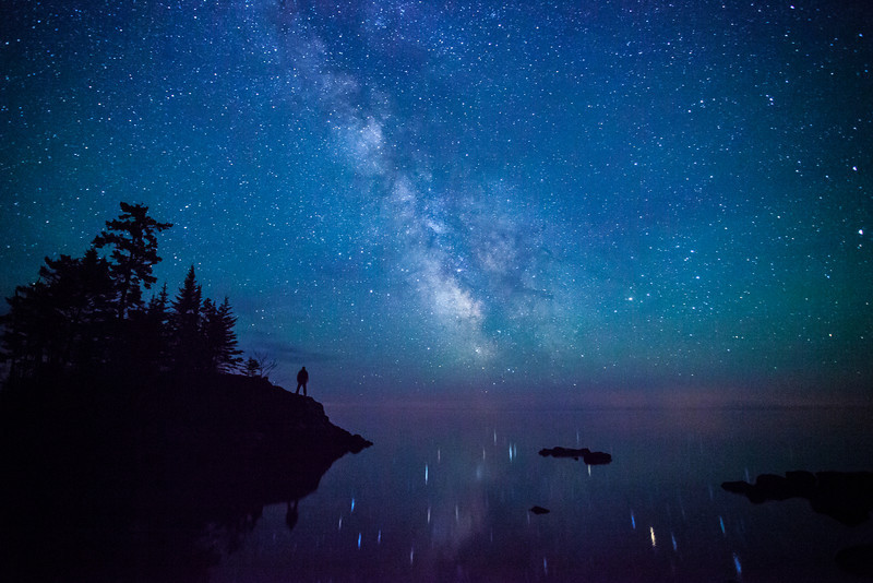 "FRIDAY, MAY 30, 2014<br /> <br /> MILKY WAY 6049<br /> <br /> ""The Milky Way over Tombolo Island - Superior Hiking Trail""<br /> <br /> I love the night sky and I am so thankful that we have nice dark skies here in northern Minnesota!  I can't imagine not being able to see the Milky Way like this when I look up at the sky at night.  We have some of the best night sky views in the country, as this photo proves.  This is looking south over Lake Superior along the lake walk section of the Superior Hiking Trail near County Road 14 just north of Grand Marais.  <br /> <br /> The stillness of the big lake that night was astounding.  I could easily see a multitude of stars reflected in the water.  This is not a common sight on Lake Superior, as usually there is enough wind stirring the lake's surface that you don't get these nice star reflections.  Another oddity is that there was a beaver swimming around in the big lake.  I never saw him, but I could hear him slap his tail on the water every now and then.  There is some marshy land in this area so that must be where the beaver came from.  I think he was enjoying the supreme calm of Lake Superior that night as well :-)<br /> <br /> Camera: Canon EOS 5D Mark II<br /> Lens: Canon EF 17-40mm<br /> Focal length: 17mm<br /> Shutter speed: 30 seconds<br /> Aperture: f/4<br /> ISO: 6400"