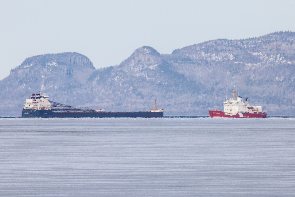 "THURSDAY, MAY 8, 2014<br /> <br /> SUPERIOR BOATS 5121<br /> <br /> ""May Icebreaking Operations in Thunder Bay""<br /> <br /> I made a trip up to Thunder Bay yesterday and this is what I saw going on out on the lake.  A Coast Guard icebreaker had just cleared a path through the ice to the open water near Pie Island and had turned around to head back into the bay.  A freighter was following close behind.  I captured this image from the shoreline of the Fort William First Nation as the icebreaker was heading back into the bay just before it passed by the freighter.  The Sleeping Giant Peninsula is in the background, with the Head of the Giant on the left side of the photo.<br /> <br /> Camera: Canon EOS 5D Mark II<br /> Lens: Tamron SP 150-600mm<br /> Focal length: 600mm<br /> Shutter speed: 1/800<br /> Aperture: f/16<br /> ISO: 1000"