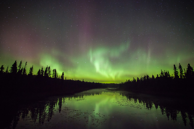 "WEDNESDAY, OCTOBER 1, 2014<br /> <br /> AURORA 9935<br /> <br /> ""Northern Lights - Cascade River""<br /> <br /> In the early morning hours of September 27, 2014 I was helping my friend Bryan Hansel Photography conduct a special night sky session of his fall color photography workshop.  We started off the evening shooting the Milky Way but just after midnight the northern lights started to flare up.  By 1:00 AM (the time this photo was made) the lights were pretty active, waving and dancing throughout the northern sky.  We took the group to the Cascade River where it crosses The Grade since that location is perfect for photographing the lights in the sky as well as their reflection in the river.  While I was busy most of the time making sure the workshop participants were tended to, I did manage to make a few images of the lights for myself.  <br /> <br /> At one point a car showed up on the road much to everyone's delight (moans and groans were aplenty as the car sat idling at the intersection of The Grade and Bally Creek Road).   I thought it might make an interesting shot so I clicked my shutter and made an image of the car in the foreground with the aurora in the background.  Every night where the lights are out is a memorable night and this was no exception.  I was glad that the aurora showed up for our night sky session, it was a special treat to an already sublime night!<br /> <br /> Camera: Canon EOS 5D Mark II<br /> Lens: Canon EF 17-40mm<br /> Focal length: 17mm<br /> Shutter speed: 30 seconds<br /> Aperture: f/4<br /> ISO: 2000"