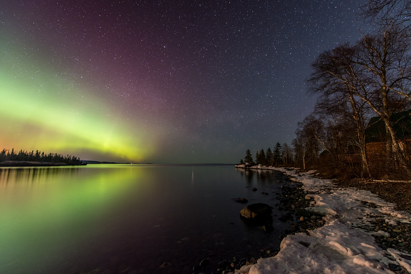 "SATURDAY, APRIL 11, 2015<br /> <br /> AURORA 3522<br /> <br /> ""Northern Lights over Hollow Rock Bay""<br /> <br /> Here is a photograph from the second location that I visited last night.  At the time I was wishing the aurora lights extended more to the right but I ended up really liking this composition even though they are only on the left side of the frame.  If you look closely you can just barely make out the ribbon of the Milky Way just above the horizon in the center of the photo.  There is a nice line that winds its way through the photo, if you follow the icy shoreline from the lower right up through the Milky Way along the horizon and towards the upper left through the glow of the aurora.  Not my absolute favorite photograph from last night, but definitely one that I like a lot.<br /> <br /> Camera: Nikon D750<br /> Lens: Nikon 14-24mm f/2.8<br /> Focal length: 14mm<br /> Shutter speed: 30 seconds<br /> Aperture: f/2.8<br /> ISO: 1600"