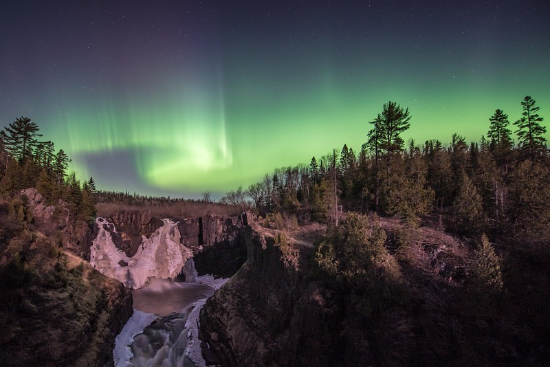 "SATURDAY, APRIL 11, 2015<br /> <br /> AURORA 3598<br /> <br /> ""Lights over High Falls""<br /> <br /> Well, there was quite the little aurora show last night!  I was out shooting from about 11 PM until 5 AM and really enjoyed the calm spring night.  I visited 6 different locations and came away with a nice variety of images, but the first one I'm sharing with you is one that I've been wanting to get for quite a while.  This was taken at High Falls of the Pigeon River in Grand Portage State Park and is a shot that will only work when you have a little bit of moonlight to illuminate the falls and the river gorge below.  Without the moonlight the foreground would be way too dark.  Also, only a little bit of moonlight will work because if the moon was too bright it would wash out the lights in the sky.  Last night's moonrise was just before 2 AM but I still had to wait a while for the moon to get high enough to shine down into the gorge.  So, I photographed a few locations along the Lake Superior shoreline before heading up to High Falls.  This photo was made at 3:35 AM and was during the brightest flare-up of the lights that I saw all night.  Look for more photos to be posted as soon as I have time to work on them.  For now, I need to head to work for the day :-)<br /> <br /> Camera: Nikon D750<br /> Lens: Nikon 14-24mm f/2.8<br /> Focal length: 14mm<br /> Shutter speed: 15 seconds<br /> Aperture: f/2.8<br /> ISO: 400"