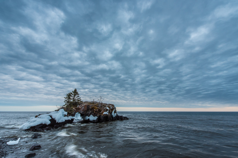 "WEDNESDAY, APRIL 15, 2015<br /> <br /> SUPERIOR SPRING 3640<br /> <br /> ""Spring Storm over Hollow Rock""<br /> <br /> The other night I went down to Hollow Rock to photograph what I hoped would be a colorful sunset. Instead what I got was this incredible cloud bank moving from west to east out over the lake.  The textures in the clouds were something else.  Clouds fascinate me and I love capturing them with my camera!<br /> <br /> Camera: Nikon D750<br /> Lens: Nikon 14-24mm f/2.8<br /> Focal length: 14mm<br /> Shutter speed: 1/6<br /> Aperture: f/16<br /> ISO: 400"
