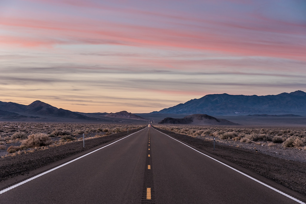 "SUNDAY, APRIL 5, 2015<br /> <br /> NEVADA 3159<br /> <br /> ""Sunset on Highway 95""<br /> <br /> Another unforgettable trip draws to a close.  This is the last image I made before our flight back home the following day from Las Vegas.  It was a fitting end to another journey that was filled with adventure and beautiful sights.  As we were driving south on Highway 95 towards Tonopah, Nevada we experienced a very nice sunset, one that I simply could not pass up.  We were driving through this broad valley staring at the colorful sky that surrounded us when I looked over at Jessica and said ""I have to stop and make a picture"".  She just looked at me, smiled and said ""I know you do"".  What can I say... WOW I love this woman!  She is so supportive of my photography, I don't know how I ever got so lucky to find her.  Even though the major reason for this trip was to visit her friends and family, she still made plenty of time for photography and planned an amazing trip for us.  I am eternally grateful to the universe for bringing us together :-)<br /> <br /> Camera: Nikon D750<br /> Lens: Nikon 24-120mm f/4<br /> Focal length: 82mm<br /> Shutter speed: 1/13<br /> Aperture: f/8<br /> ISO: 100"