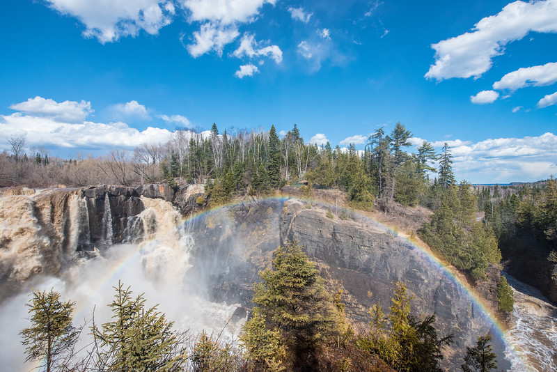 "MONDAY, APRIL 13, 2015<br /> <br /> PIGEON RIVER 3650<br /> <br /> ""Spring Rainbow over the High Falls Gorge""<br /> <br /> Camera: Nikon D750<br /> Lens: Nikon 14-24mm f/2.8<br /> Focal length: 14mm<br /> Shutter speed: 1/640<br /> Aperture: f/11<br /> ISO: 400"