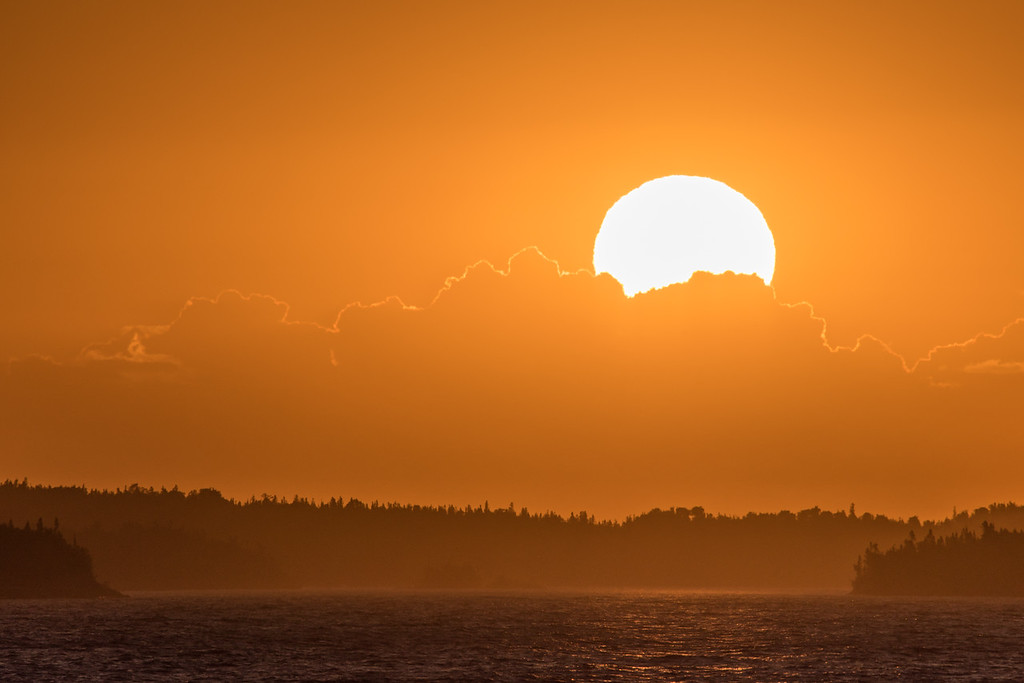 "SUNDAY, AUGUST 2, 2015<br /> <br /> SUPERIOR SUMMER 7491<br /> <br /> ""Golden Sunrise over the Susie Islands""<br /> <br /> Happy SUNday!  A glorious sunrise that I captured with my Tamron 150-600 lens a few mornings ago.  Looking across Wauswaugoning Bay at the Susie Islands and Pigeon Point, the northeastern-most tip of Minnesota.<br /> <br /> Camera: Nikon D750<br /> Lens: Tamron SP 150-600mm<br /> Focal length: 600mm<br /> Shutter speed: 1/4000<br /> Aperture: f/16<br /> ISO: 100"