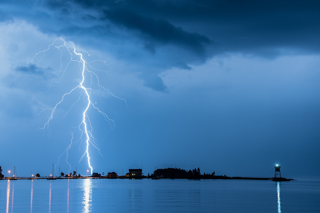 "SATURDAY, AUGUST 29, 2015<br /> <br /> LIGHTNING 9048<br /> <br /> ""Harbor Lightning""<br /> <br /> Here is another favorite from last night's series of thunderstorms over the harbor in Grand Marais, MN.<br /> <br /> Camera: Nikon D750<br /> Lens: Nikon 24-120mm f/4<br /> Focal length: 48mm<br /> Shutter speed: 11 seconds<br /> Aperture: f/8<br /> ISO: 400"