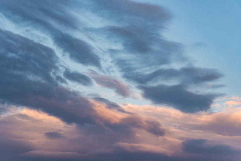 """SUNDAY, DECEMBER 13, 2015<br /> <br /> CLOUDS 4598<br /> <br /> """"Sunset Sky Abstract""""<br /> <br /> As regular followers of my photography know, I tend to post wide-angle landscapes or telephoto images of wildlife.  Every now and then, however, I do like to make abstract images and clouds are one of my favorite subjects for such things.  This is a different take on the wide-angle image I posted earlier today.  It is the same sunset as the one shown in the """"Yellowstone Sunset - Fawn Pass Trailhead"""" photo, only this time I zoomed my 24-120mm lens all the way in to make an abstract image showing just a portion of the sky.  It sure was an interesting sunset to photograph, one that was continuously changing as we watched.  I love the little cloud that is right in the center of the photo.  It has quite a variety of color and texture in it.  <br /> <br /> Camera: Nikon D750<br /> Lens: Nikon 24-120mm f/4<br /> Focal length: 120mm<br /> Shutter speed: 1/100<br /> Aperture: f/11<br /> ISO: 400"""
