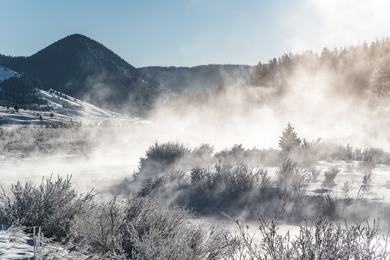 "THURSDAY, DECEMBER 3, 2015<br /> <br /> MONTANA 4736<br /> <br /> ""Frosty Morning over the Gallatin River and Black Butte""<br /> <br /> The air was bitterly cold the morning we left West Yellowstone.  As we drove north along Highway 191 the temperature (according to our car, which we've found to be quite accurate) dipped to 26 below zero.  A bit colder than we are used to for late November!  Once we reached the Gallatin River, though, the cold temperature made for some beautiful scenes along the river.  The temperature clash between the cold air and the warmer water made for lots of steam and frost along the river corridor.  We stopped at a pullout that features a view of the river with Black Butte in the distance.  It sure was a beautiful way to end our fun week in West Yellowstone!<br /> <br /> Camera: Nikon D750<br /> Lens: Nikon 24-120mm f/4<br /> Focal length: 120mm<br /> Shutter speed: 1/1000<br /> Aperture: f/16<br /> ISO: 400"