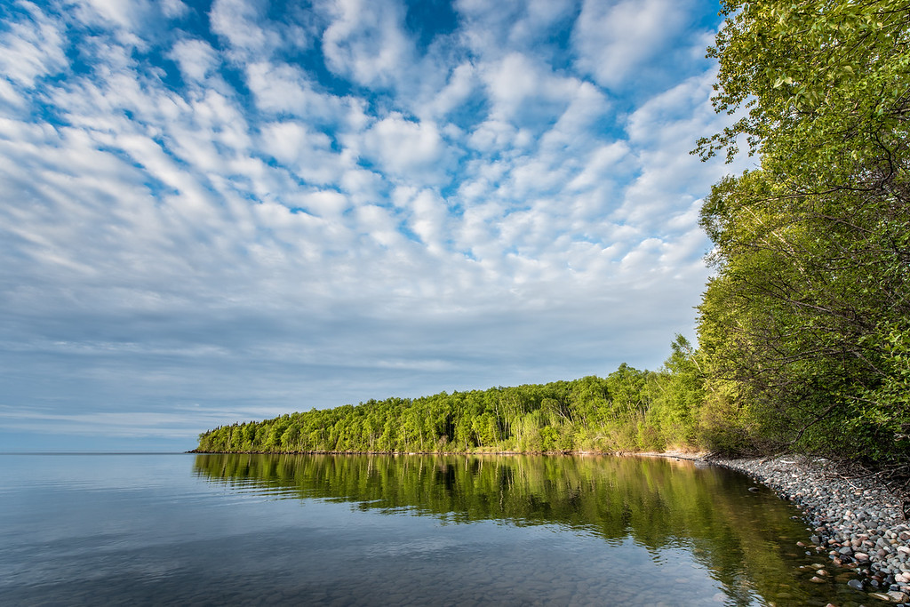 "WEDNESDAY, JULY 1, 2015<br /> <br /> SUPERIOR SUMMER 5799<br /> <br /> ""Cannonball Bay Morning""<br /> <br /> There's nothing quite like the beauty of a supremely calm summer morning on the shores of Lake Superior!  <br /> <br /> Camera: Nikon D750<br /> Lens: Nikon 14-24mm f/2.8<br /> Focal length: 14mm<br /> Shutter speed: 1/30<br /> Aperture: f/11<br /> ISO: 100"