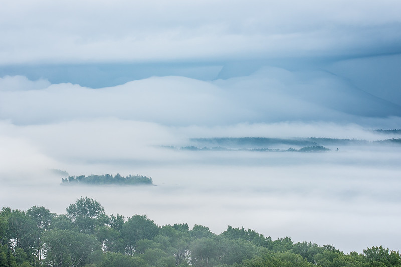 "MONDAY, JULY 13, 2015<br /> <br /> SUPERIOR SUMMER 7073<br /> <br /> ""The Lake Superior Fog Factory""<br /> <br /> This is what is happening right now over the Susie Islands in Grand Portage, MN.  I just drove home from work and saw this insanely cool fog over Lake Superior.  It rained for most of the day and now that the rain has stopped you can really feel the high humidity in the wake of the receding weather front.  We've had a lot of fog in Grand Portage this year, but none quite like this.  I see a lot of foggy views as I drive past these islands on my way to and from work every day but this is one of the most unbelievable foggy views I've seen.  I call it ""The Lake Superior Fog Factory"".<br /> <br /> Camera: Nikon D750<br /> Lens: Tamron SP 150-600mm<br /> Focal length: 150mm<br /> Shutter speed: 1/400<br /> Aperture: f/11<br /> ISO: 400"