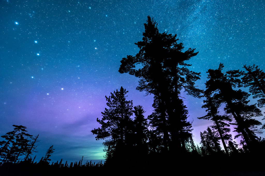 """MONDAY, JUNE 22, 2015<br /> <br /> MILKY WAY 6047<br /> <br /> """"2015 Summer Solstice Night Sky""""<br /> <br /> Last night Jessica and I spent the majority of the night out in search of the northern lights. The aurora was supposed to be really active according to space weather forecasts but unfortunately it was not.  We only saw a little glimpse of the lights around 2:00 AM just before the clouds moved in.  But, that glimpse was beautiful with hints of green and purple.  Also, the views of the stars last night were unreal!  The stars were unbelievably vivid, especially once the clouds first started to move in.  The leading edge of the cloud cover seemed to be this really light haze, which actually made the more prominent stars (such as those in the Big Dipper) really jump out from the sky.  The haze seemed to create a slight halo around those brighter stars, making them appear much larger than normal in my photos.  Even when things don't work out the way you hope they will, a night spent in the north woods is a night to remember!<br /> <br /> Camera: Nikon D750<br /> Lens: Nikon 14-24mm f/2.8<br /> Focal length: 14mm<br /> Shutter speed: 30 seconds<br /> Aperture: f/2.8<br /> ISO: 6400"""
