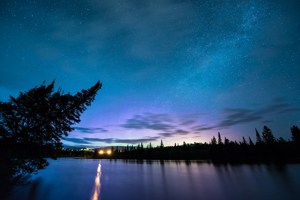 "TUESDAY, JUNE 16, 2015<br /> <br /> MILKY WAY 5674<br /> <br /> ""Aurora Teaser""<br /> <br /> Just a hint of northern lights last night over the Pigeon River in Grand Portage, MN.  I went out to spend the night photographing the Milky Way but was pleasantly surprised in this photo to see a little bit of aurora action going on.  Some faint purple and green colors low on the northern horizon mixed in with some slight light pollution from the city of Thunder Bay, Ontario which is about 40 miles away.<br /> <br /> Camera: Nikon D750<br /> Lens: Nikon 14-24mm f/2.8<br /> Focal length: 14mm<br /> Shutter speed: 30 seconds<br /> Aperture: f/2.8<br /> ISO: 3200"