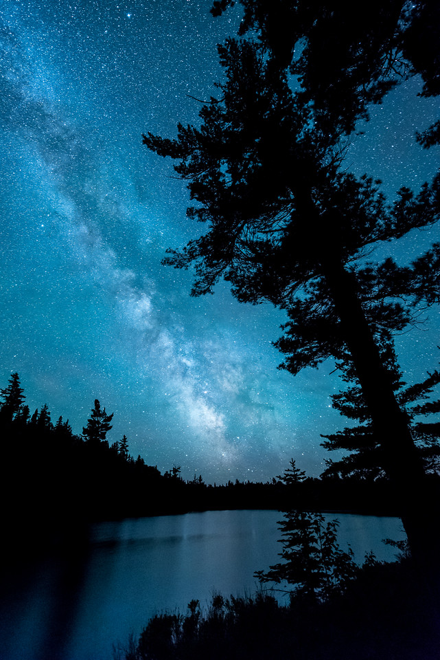 """FRIDAY, JUNE 26, 2015<br /> <br /> MILKY WAY 5993<br /> <br /> """"The calm before the storm""""<br /> <br /> June 22, 2015 - This is what the night sky looked like the evening before the big geomagnetic storm hit earlier this week.  This was the night of the summer solstice and the aurora borealis was supposed to hit our atmosphere big time but it ended up being delayed until the following night.  Since the aurora forecast was so good, Jessica and I headed out and spent the entire night waiting for the lights.  We had a little showing of them between 2 and 3 AM, but nothing at all like what we ended up witnessing the following night.  Still, it was an unbelievably beautiful night.  The views of the Milky Way were some of the best I've seen.  The night was so dark and the stars were so crisp and clear.  It was a surreal experience to stand and gaze up at such an incredible sky!<br /> <br /> Camera: Nikon D750<br /> Lens: Nikon 14-24mm f/2.8<br /> Focal length: 14mm<br /> Shutter speed: 30 seconds<br /> Aperture: f/2.8<br /> ISO: 6400"""