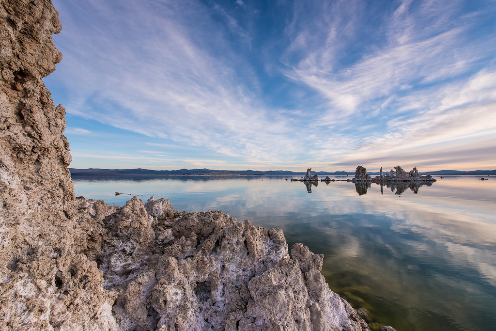 "TUESDAY, MARCH 31, 2015<br /> <br /> CALIFORNIA 2120<br /> <br /> ""Mono Lake Morning""<br /> <br /> After a too-short night of rest back at the motel in Lee Vining, we rose early to head back out to Mono Lake for sunrise.  As much as we wanted some more sleep, we also knew that we only had one chance for a sunrise at this location so we seized the opportunity.  And boy are we glad we didn't miss the opportunity because we sure had a beautiful morning!  The clouds were spectacular and the stillness of the air was unbelievable.  The tufa formations were fascinating.  Definitely a very strange and surreal landscape!<br /> <br /> From the Mono Lake Tufa State Natural Reserve web page: <br /> <br /> ""Mono Lake is a majestic body of water covering about 65 square miles.  It is an ancient lake at over 1 million years old and one of the oldest lakes in North America.  It has no outlet.  Throughout the lake's existence, salts and minerals have washed into the lake from Easter Sierra streams.  Fresh water evaporating from the lake each year has left the salts and minerals behind so that the lake is now about 2 1/2 times as salty as the ocean and very alkaline.  The Mono Lake Tufa State Natural Reserve was established to protect the spectacular ""tufa towers"", calcium-carbonate spires and knobs formed by interaction of fresh water springs and alkaline lake water.""<br /> <br /> Camera: Nikon D750<br /> Lens: Nikon 14-24mm f/2.8<br /> Focal length: 14mm<br /> Shutter speed: 1/20<br /> Aperture: f/16<br /> ISO: 100"
