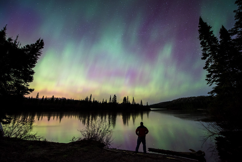 """TUESDAY, MAY 13, 2015<br /> <br /> AURORA 5187<br /> <br /> """"Front Row Seat for the Aurora Show!""""<br /> <br /> Here is another photo from last night's aurora storm, this one taken at 1:00 AM along the Pigeon River in Grand Portage, MN.  I love photographing the aurora when you have a strong water element that you can include in your foreground.  Having calm water to reflect what's going on in the sky sure adds a lot to a photo!  For those that may not know, the Pigeon River in northeast Minnesota is the international border between the United States and Ontario, Canada.  I am standing on the Minnesota side, looking across the river at Canada.<br /> <br /> Camera: Nikon D750<br /> Lens: Nikon 14-24mm f/2.8<br /> Focal length: 14mm<br /> Shutter speed: 20 seconds<br /> Aperture: f/2.8<br /> ISO: 1600"""