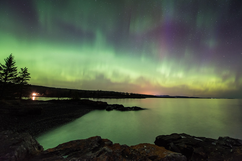 "SUNDAY, MAY 17, 2015<br /> <br /> AURORA 5238<br /> <br /> ""Aurora Borealis over Hollow Rock Bay""<br /> <br /> Here's one more image that I wanted to share from the aurora storm the morning of May 13, 2015.  Taken at Hollow Rock Resort in Grand Portage, MN.  This was at about 2:30 in the morning as the storm was going full blast.  The lights were so strong that they were really illuminating the surface of Lake Superior and the rocks along the shoreline.  I had my headlamp on when I was walking around, but the lights were so bright I probably could have gotten by without it!<br /> <br /> Camera: Nikon D750<br /> Lens: Nikon 14-24mm f/2.8<br /> Focal length: 14mm<br /> Shutter speed: 20 seconds<br /> Aperture: f/2.8<br /> ISO: 1600"