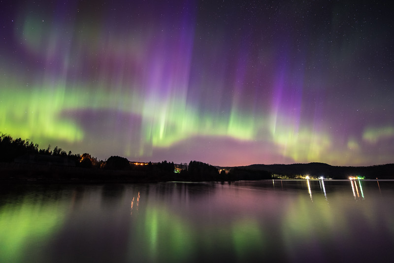 """WEDNESDAY, MAY 13, 2015<br /> <br /> AURORA 5288<br /> <br /> """"Aurora Explosion!""""<br /> <br /> It sure was nice to see the aurora borealis reach storm level tonight!  Unexpected, for sure, at least by me. I knew there was some activity in the forecast for tonight, but I didn't expect it to get as good as it did!  The best I saw was around 3:15 AM, when this photo was made.  I was standing on the end of the dock at Grand Portage National Monument in Grand Portage Bay, looking back towards shore.  The sky was filled with ever-changing patterns of the aurora.  One of the best shows I've seen yet in northern Minnesota!<br /> <br /> Camera: Nikon D750<br /> Lens: Nikon 14-24mm f/2.8<br /> Focal length: 14mm<br /> Shutter speed: 15 seconds<br /> Aperture: f/2.8<br /> ISO: 1600"""