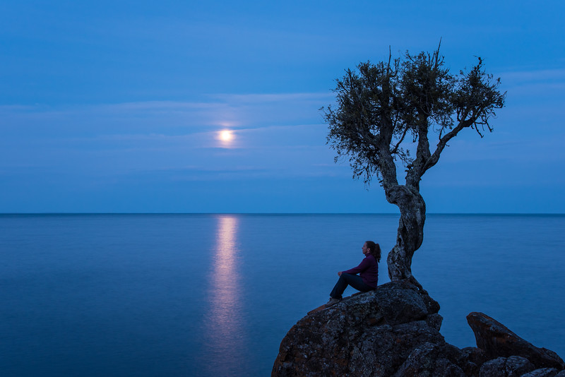 "TUESDAY, MAY 5, 2015<br /> <br /> SPIRIT TREE 4640<br /> <br /> ""Full Moon Contemplation at the Spirit Tree""<br /> <br /> Enjoying a quiet spring evening at the Spirit Tree as the full moon rises over the Lake Superior horizon. <br /> <br /> Grand Portage, MN <br /> <br /> Reminder: Access to the Spirit Tree is only permitted when accompanied by a Grand Portage tribal member. <br /> <br /> Camera: Nikon D750<br /> Lens: Nikon 24-120mm f/4<br /> Focal length: 44mm<br /> Shutter speed: 4 seconds<br /> Aperture: f/16<br /> ISO: 400"