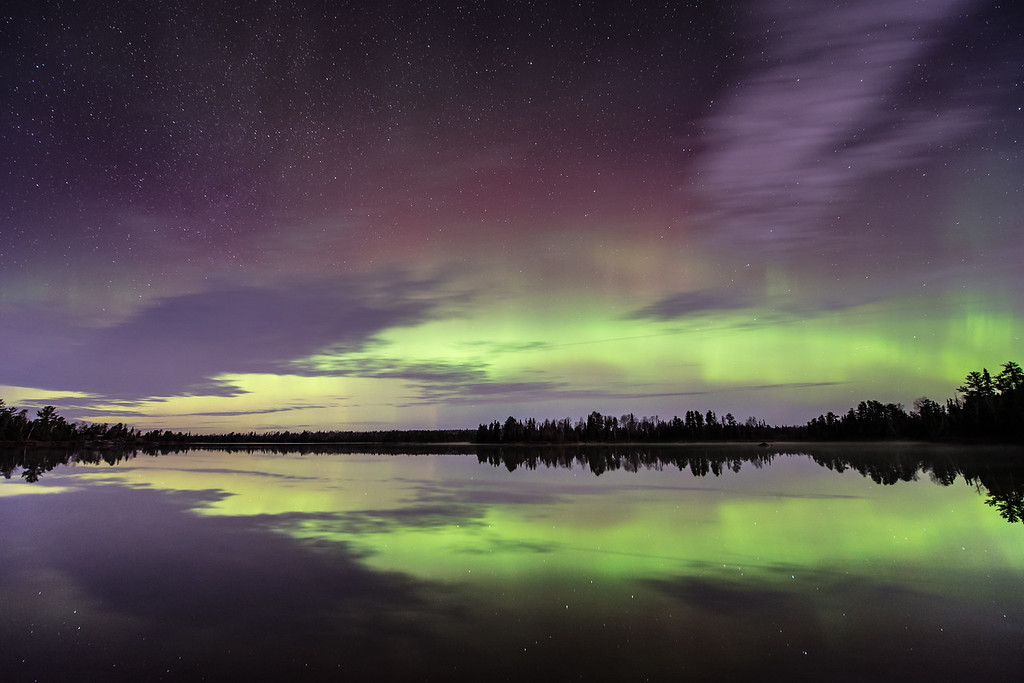 "WEDNESDAY, NOVEMBER 4, 2015<br /> <br /> AURORA 4180<br /> <br /> ""November Lights over Kawishiwi Lake""<br /> <br /> And this is how my night ended in the early morning hours of November 3rd.  Clouds moving in from the west that soon covered the entire sky for the remainder of the night.  For a little while, though, I enjoyed a period of pristine calm conditions on Kawishiwi Lake in Superior National Forest.  The northern lights continued to glow in the northern sky but with a little less intensity and variety in color than what I had witnessed earlier in the night.  I enjoyed watching that gray cloud moving in from the left and its perfect reflection as it marched from west to east across the lake.  It was a beautiful end to an amazing night of photography and aurora watching!<br /> <br /> Camera: Nikon D750<br /> Lens: Nikon 14-24mm f/2.8<br /> Focal length: 14mm<br /> Shutter speed: 20 seconds<br /> Aperture: f/2.8<br /> ISO: 1600"