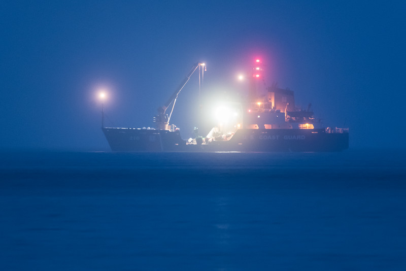 """THURSDAY, NOVEMBER 5, 2015<br /> <br /> SUPERIOR BOATS 4246<br /> <br /> """"USCG Cutter 'Alder' retrieving the Hat Point bell buoy""""<br /> <br /> Last night as we were driving home after an afternoon in the woods we were treated to a rare sight.  The United States Coast Guard Cutter """"Alder"""" was pulling the Hat Point Bell Buoy for the season.  Indeed, this happens every year, which doesn't exactly count as """"rare"""", but usually they pull it in the 3rd week or so of October and usually during the day.  This time the sun had already set and they were retrieving the buoy during the """"blue hour"""" that occurs after sunset.  It was cool to see the ship lit up not only with the navigational lights but also all the work lights as the crew pulled the buoy from the reef between Hat Point and Pete's Island.  <br /> <br /> The ship was roughly a mile away so in order to make this shot I had to use my Tamron 150-600mm lens set to 600mm, not an easy feat in such low light conditions.  I mounted the lens on my tripod, set the camera to an ISO setting of 3200, set the aperture to f/8 in aperture-priority mode, set the timer to release the shutter 5 seconds after pressing the shutter button, then made this shot.  The exposure time was 2 seconds, and thankfully the conditions were calm enough that the boat did not move at all during those 2 seconds so I was able to get a nice, sharp image.<br /> <br /> Camera: Nikon D750<br /> Lens: Tamron SP 150-600mm<br /> Focal length: 600mm<br /> Shutter speed: 2 seconds<br /> Aperture: f/8<br /> ISO: 3200"""