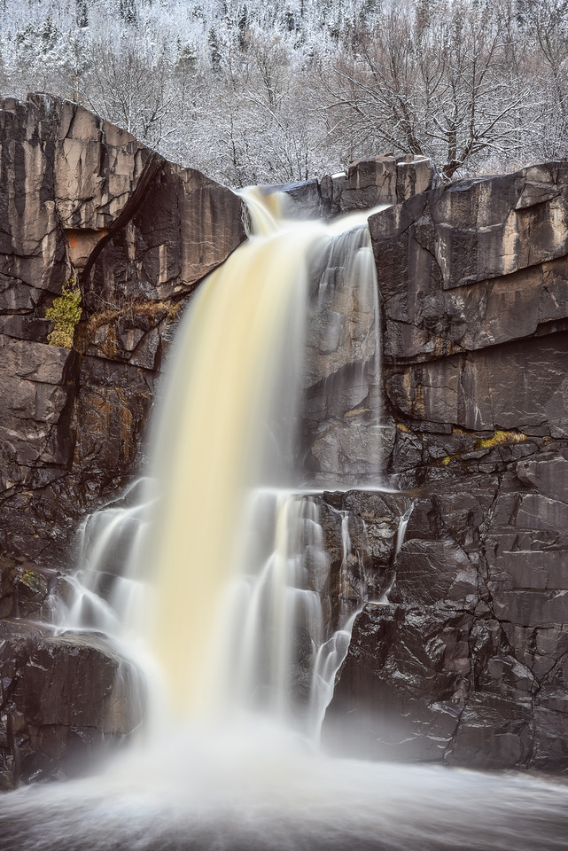 "WEDNESDAY, NOVEMBER 18, 2015<br /> <br /> PIGEON RIVER 4335<br /> <br /> ""November Snowfall, Minnesota's Tallest Waterfall""<br /> <br /> November snowfall at Minnesota's tallest waterfall, High Falls of the Pigeon River in Grand Portage State Park, MN.<br /> <br /> Camera: Nikon D750<br /> Lens: Nikon 24-120mm f/4<br /> Focal length: 105mm<br /> Shutter speed: 4 seconds<br /> Aperture: f/16<br /> ISO: 100"
