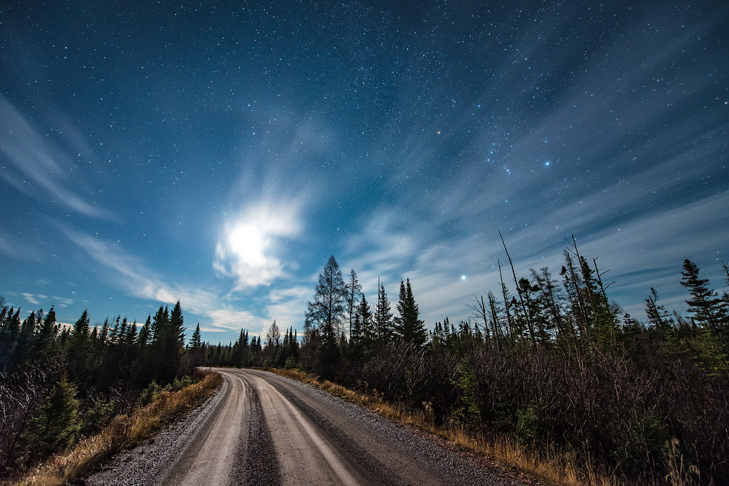 "FRIDAY, NOVEMBER 6, 2015<br /> <br /> MOONLIGHT 4157<br /> <br /> ""Back Roads Moonlight, Superior National Forest""<br /> <br /> A beautiful star-filled sky complemented by the light of a half-moon while driving the back roads of Superior National Forest in northeast Minnesota.  Notice the constellation Orion in the sky in the upper right quarter of the photo.  <br /> <br /> Camera: Nikon D750<br /> Lens: Nikon 14-24mm f/2.8<br /> Focal length: 14mm<br /> Shutter speed: 30 seconds<br /> Aperture: f/2.8<br /> ISO: 1600"