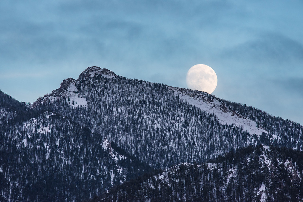 "TUESDAY, NOVEMBER 24, 2015<br /> <br /> MONTANA 4512<br /> <br /> ""Moonrise over the Madison Range""<br /> <br /> Jessica and I are in West Yellowstone for the Yellowstone Ski Festival and some sightseeing. This afternoon after our morning ski we went for a drive around the Madison Range.  As we were driving south along the western side of the range we saw a beautiful moon rising over the mountains just before sunset.<br /> <br /> Camera: Nikon D750<br /> Lens: Nikon 300mm f/4 PF and Nikon 1.4x III teleconverter<br /> Focal length: 420mm<br /> Shutter speed: 1/640<br /> Aperture: f/8<br /> ISO: 1000"