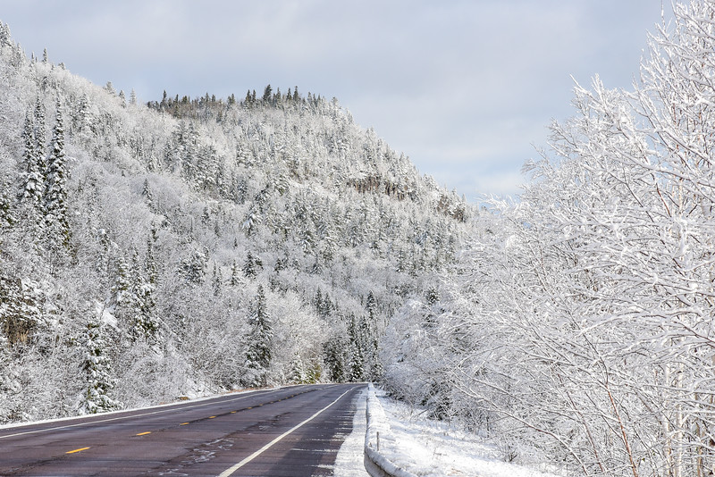"MONDAY, NOVEMBER 16, 2015<br /> <br /> GRAND PORTAGE 4300<br /> <br /> ""Winter Highway Wonderland""<br /> <br /> I sure do love mornings where there is fresh snow coating all the trees on my drive to work!  I already have one of the prettiest commutes in the state of Minnesota, but the snow makes it even prettier.  This is Highway 61 just a couple of miles south of the Canadian border in Grand Portage, MN.<br /> <br /> Camera: Nikon D750<br /> Lens: Nikon 24-120mm f/4<br /> Focal length: 120mm<br /> Shutter speed: 1/400<br /> Aperture: f/16<br /> ISO: 800"