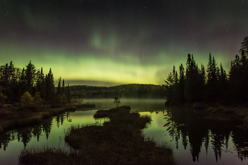 "THURSDAY, OCTOBER 8, 2015<br /> <br /> AURORA 2790<br /> <br /> ""A North Woods Night""<br /> <br /> One of the first photographs I made of the northern lights in the early morning hours of October 7, 2015.  The aurora storm started off quietly, with a soft glow just above the tree line.  By about 2:00 AM the activity was picking up considerably and there was a ribbon of light undulating across the northern sky.  Between 3 AM and 5 AM the sky exploded and the aurora was dancing like crazy.  It sure was a fun night.  The area shown in this photograph I think really exemplifies what a lot of people might think of when they think of a typical north woods lake scene.  Add in the northern lights on a beautiful fall night and you get ""A North Woods Night""  :-)<br /> <br /> Camera: Nikon D750<br /> Lens: Nikon 14-24mm f/2.8<br /> Focal length: 22mm<br /> Shutter speed: 20 seconds<br /> Aperture: f/2.8<br /> ISO: 1000"