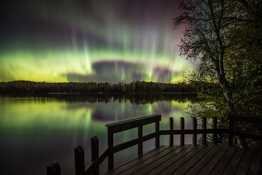 "THURSDAY, OCTOBER 29, 2015<br /> <br /> AURORA 2851<br /> <br /> ""October Aurora over Pine Lake""<br /> <br /> I guess it hasn't really been that long since our last good showing of northern lights, but it sure feels like it's been a long time!  To satisfy my craving for the lights I was looking at images from the last major event that we had and came across one I hadn't worked on yet from the early morning hours of October 7th.  This is a fishing platform on the shoreline of Pine Lake just outside of Grand Marais, MN.  The platform provides not only a nice place to fish from but also a nice place to watch the northern lights!<br /> <br /> Camera: Nikon D750<br /> Lens: Nikon 14-24mm f/2.8<br /> Focal length: 14mm<br /> Shutter speed: 15 seconds<br /> Aperture: f/2.8<br /> ISO: 800"