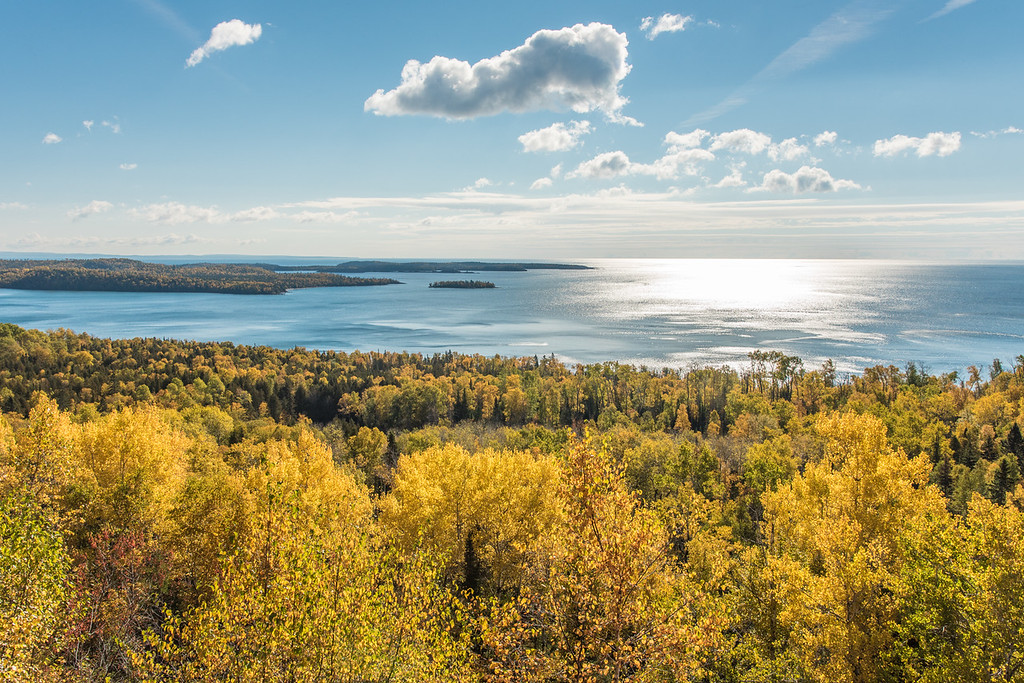 "SUNDAY, OCTOBER 10, 2015<br /> <br /> AUTUMN 2995<br /> <br /> ""Golden Shores in Grand Portage""<br /> <br /> <br /> It looks like this weekend was probably the end of the peak color season, at least here in Grand Portage.  The colors were about as perfect as they get on Friday on Saturday, but on Saturday it was pretty windy all day and that knocked a lot of leaves off the trees.  There should still be good color up here for a few days at least, but it will be past peak.  I stopped and made this photo on my way to work on Friday.  It was taken from the pullout on Highway 61 that overlooks Lake Superior and the Susie Islands.<br /> <br /> Camera: Nikon D750<br /> Lens: Nikon 24-120mm f/4<br /> Focal length: 32mm<br /> Shutter speed: 1/640<br /> Aperture: f/16<br /> ISO: 400"