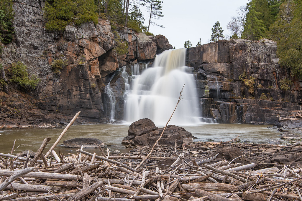 "SUNDAY, OCTOBER 25, 2015<br /> <br /> ONTARIO 4009-2<br /> <br /> ""Driftwood at Arrow River Falls""<br /> <br /> Remnants of a time when the water level was much higher, a large log jam covers about 3/4 of the width of the river below the pool at the base of Arrow River Falls.<br /> <br /> Camera: Nikon D750<br /> Lens: Nikon 16-35mm f/4<br /> Focal length: 35mm<br /> Shutter speed: 2.5 seconds<br /> Aperture: f/16<br /> ISO: 100"