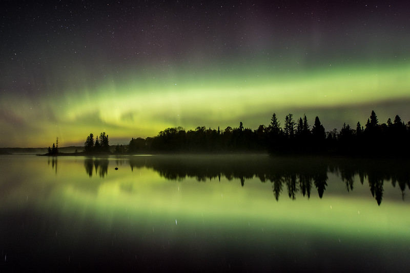 "WEDNESDAY, OCTOBER 7, 2015<br /> <br /> AURORA 2866<br /> <br /> ""October Aurora over Devil Track Lake""<br /> <br /> The last image I made before calling it a night last night.  After several hours of great fun watching and photographing an awesome aurora storm, this image was made at 5:17 AM over Devil Track Lake near Grand Marais, MN.<br /> <br /> Camera: Nikon D750<br /> Lens: Nikon 14-24mm f/2.8<br /> Focal length: 24mm<br /> Shutter speed: 15 seconds<br /> Aperture: f/2.8<br /> ISO: 1250"