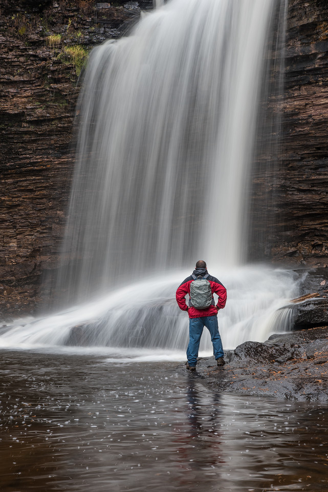 "THURSDAY, OCTOBER 22, 2015<br /> <br /> ONTARIO 3886<br /> <br /> ""Wolf River Falls""<br /> <br /> I spent yesterday exploring some waterfalls that I had never been to before.  It was a dreary, rainy day.  Perfect for exploring rivers and waterfalls!  By the end of the day I was pretty wet but extremely satisfied having found the waterfalls I was looking for.  There was a real possibility that I would not find them since I hadn't been to them before and they were in pretty remote locations (20+ miles down some wet and sloppy dirt roads) and not marked.  There were trails to them but they were not signed and were quite difficult to access, especially on a wet day.  The slopes I had to scale to get to them were extra treacherous in the wet weather.  Thankfully previous hikers had left ropes and in one instance, a small ladder to aid in climbing down to the waterfalls.  All in all, it was a fun day of challenge and adventure!<br /> <br /> Camera: Nikon D750<br /> Lens: Nikon 24-120mm f/4<br /> Focal length: 75mm<br /> Shutter speed: 0.4 seconds<br /> Aperture: f/16<br /> ISO: 100"